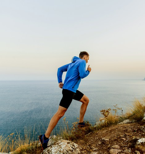 running uphill male athlete runner outdoor training